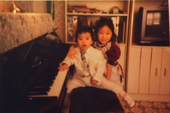 My brother, William, and I at our piano at home!